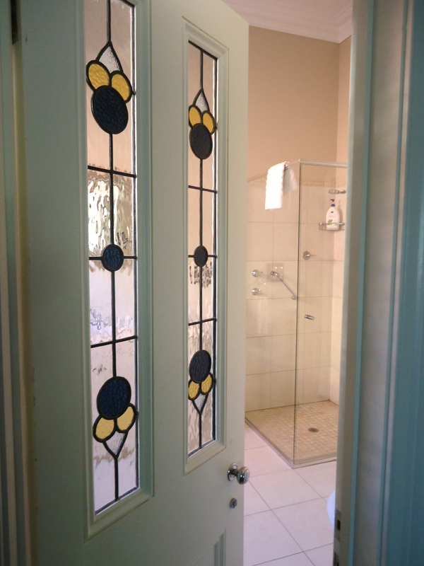 Beautiful leadlighting looking through to the Camellia Room's private ensuite